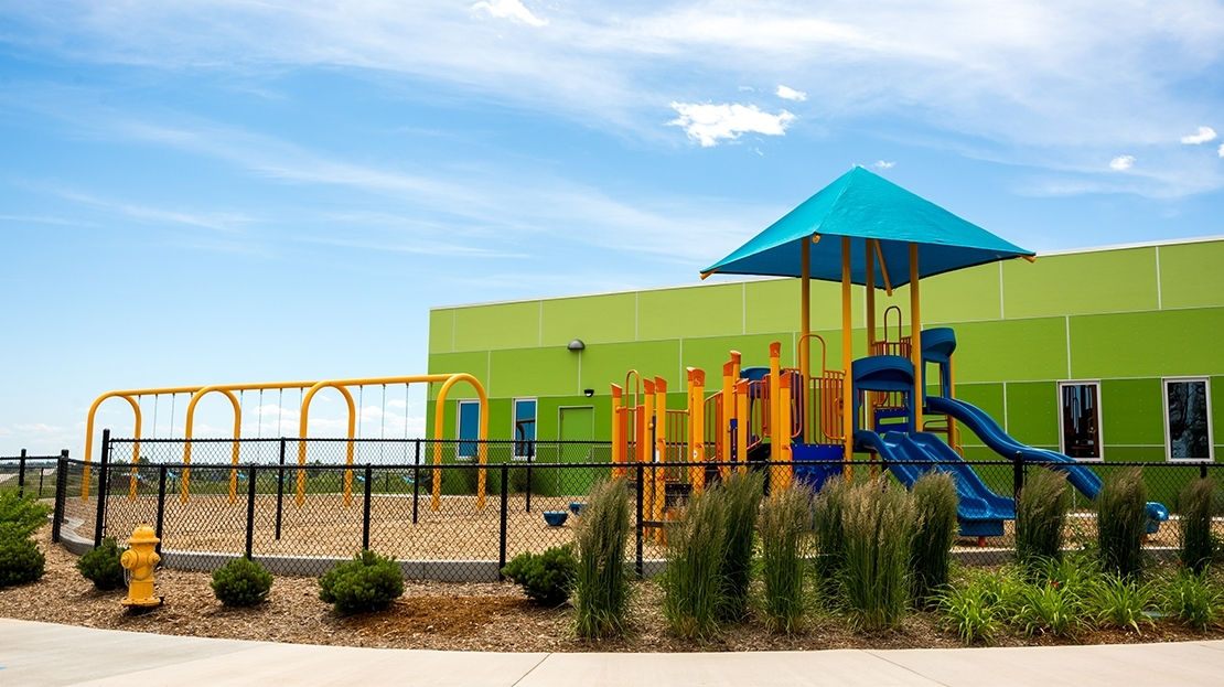 bright colored church playground with swings in colorado