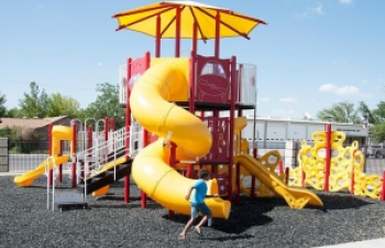 playground with shade and tube slide