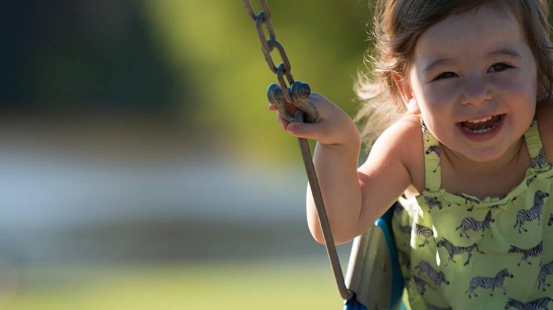 girl on swings at morrison park
