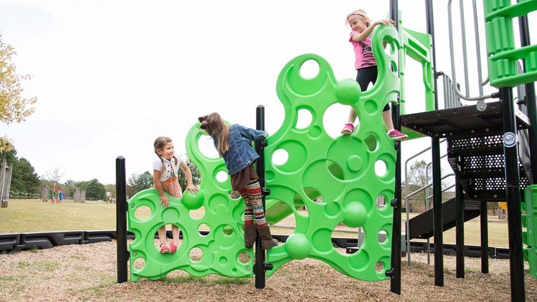 children on playground climber