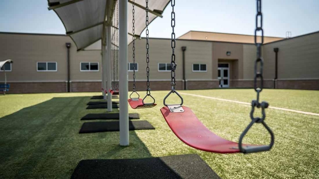 shaded playground swing